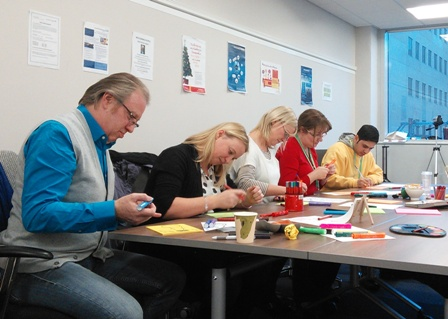 DPG classmates learning the art of effective poster making during our Demo Sessions Day